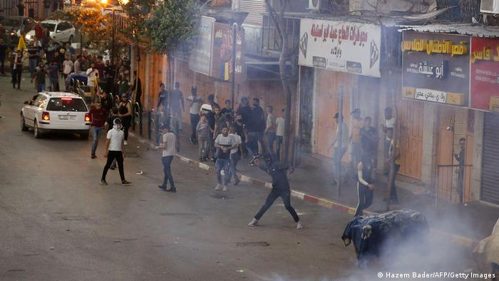 Столкновения между палестинскими протестующими и израильскими службами безопасности в городе Хеврон, 12 мая 2021 года